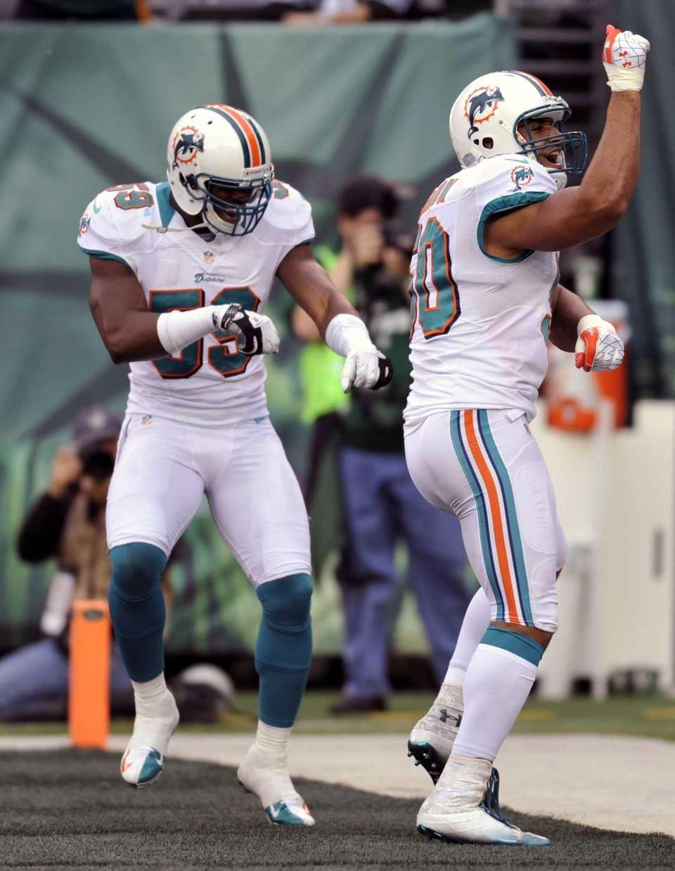 Miami Dolphins' Olivier Vernon (50) celebrates with teammate