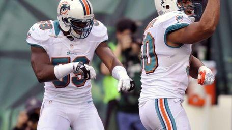 Miami Dolphins' Olivier Vernon (50) celebrates with teammate