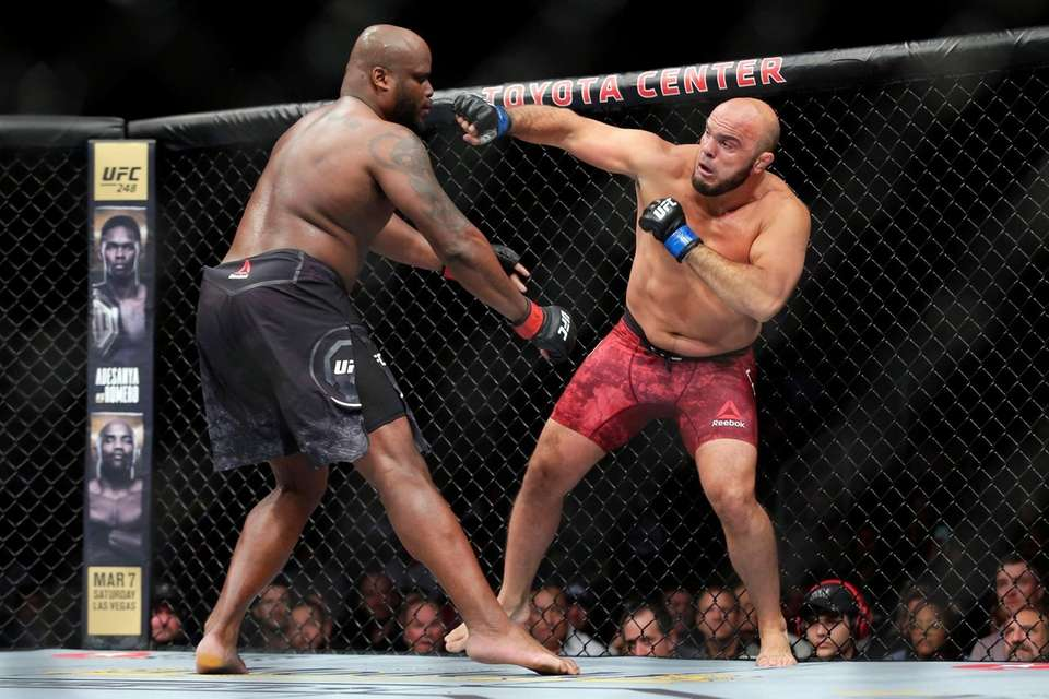 Derrick Lewis, left, tries to avoid a right
