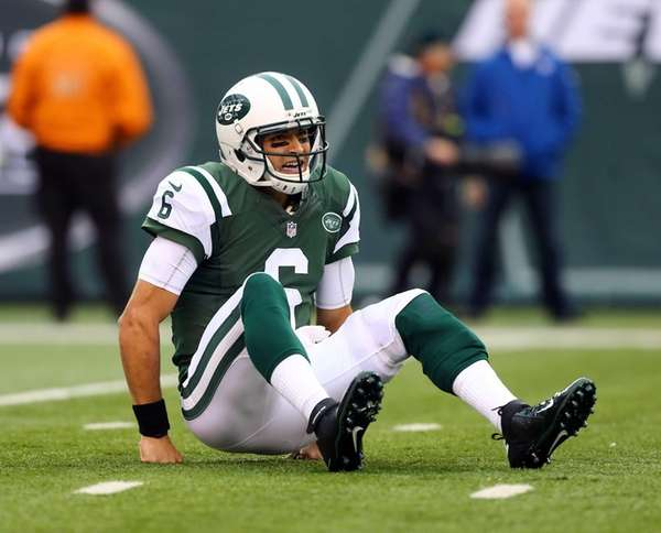 Mark Sanchez looks on after he was knocked