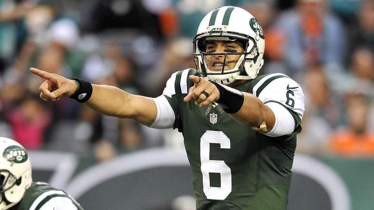 Mark Sanchez calls an audible during the second