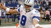 Dallas Cowboys quarterback Tony Romo celebrates his touchdown