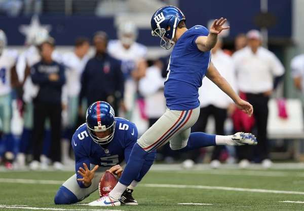 Lawrence Tynes kicks a field goal during a