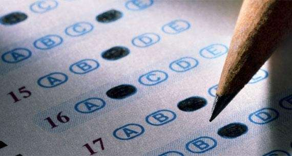 A pencil fills out a multiple choice exam.