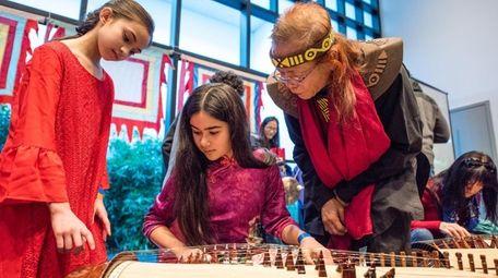 Catalina Kreeitzman, 10, left, of Smithtown, learns to