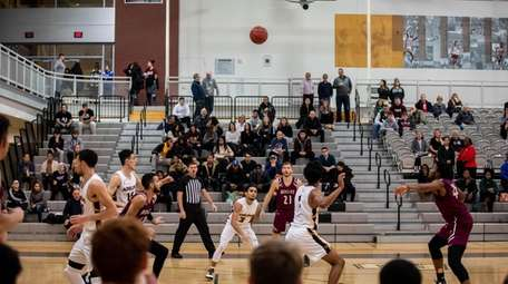 Residents watch the Adelphi men's basketball team play
