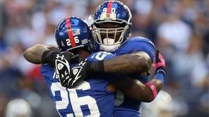 Jason Pierre-Paul celebrates his interception for a touchdown