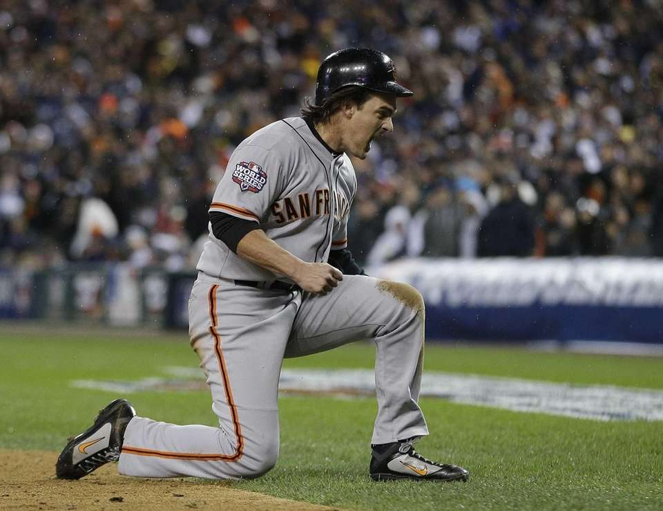 San Francisco Giants designated hitter Ryan Theriot reacts
