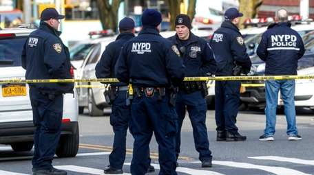 Officials: Gunman shot NYPD officers in Bronx and precinct in ...