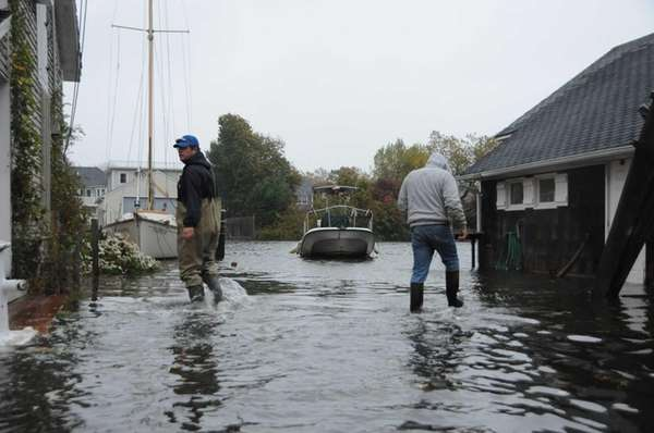 Owners check on their boats along Willow Street
