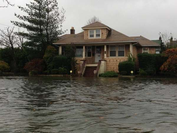Water comes above the front steps of a
