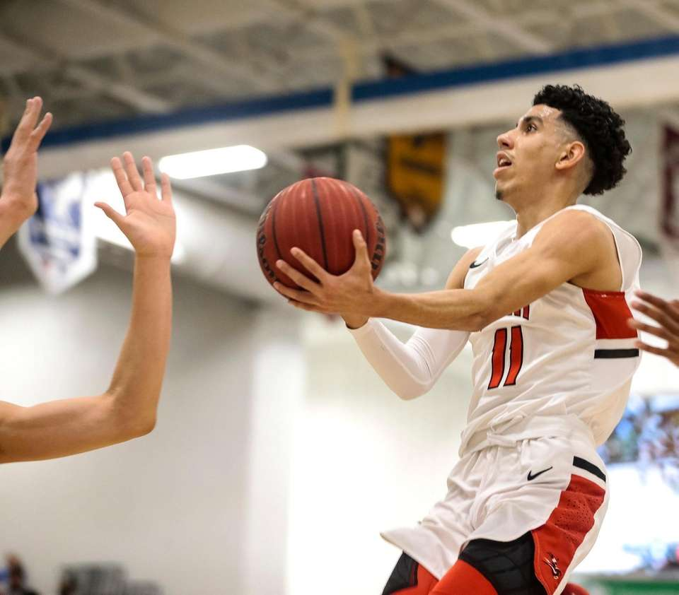 Andre Curbelo of Long Island Lutheran goes to