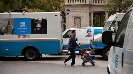 Con Edison trucks line up in Union Square,