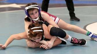 Bay Shore's Mora Peterson (top) looks to pin