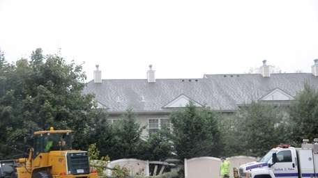 Winds from superstorm Sandy topple a large tree