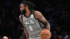 Nets center DeAndre Jordan dribbles the ball against