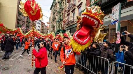 Colorful Dragons and Lions delight spectators at the