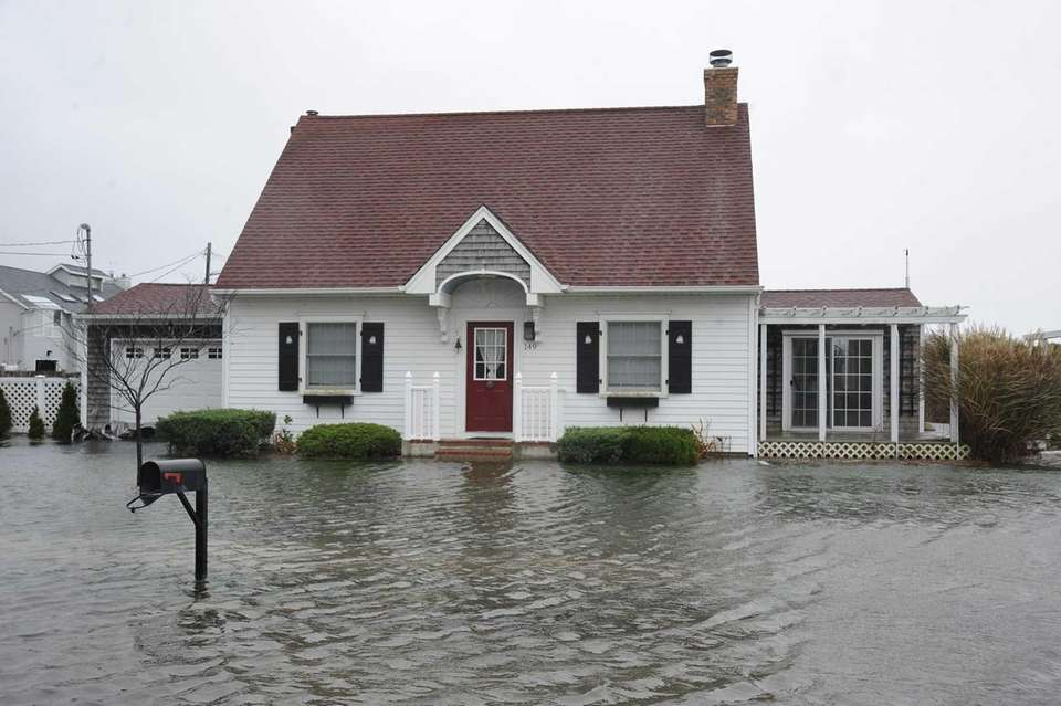 Moriches Bay floods at the intersection of South