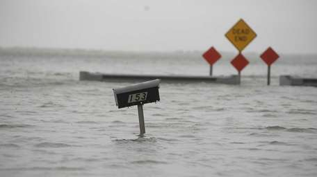 Water from Moriches Bay floods South Ocean Avenue