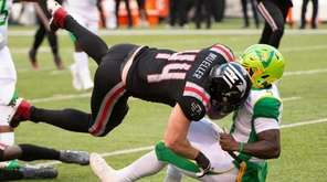 New York Guardians #44 Ryan Mueller tackles Tampa