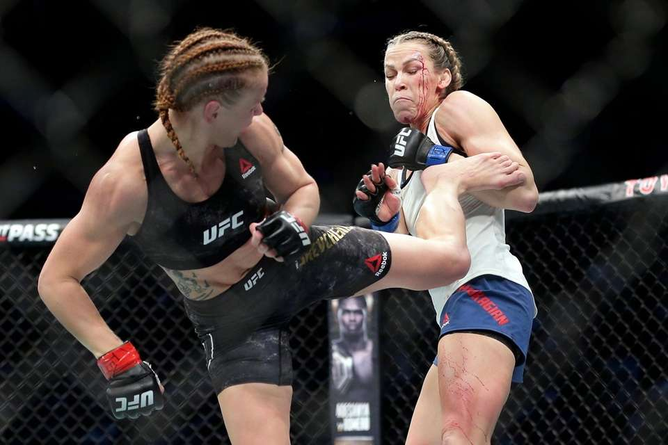 Valentina Shevchecko, left, delivers a kick to Katlyn