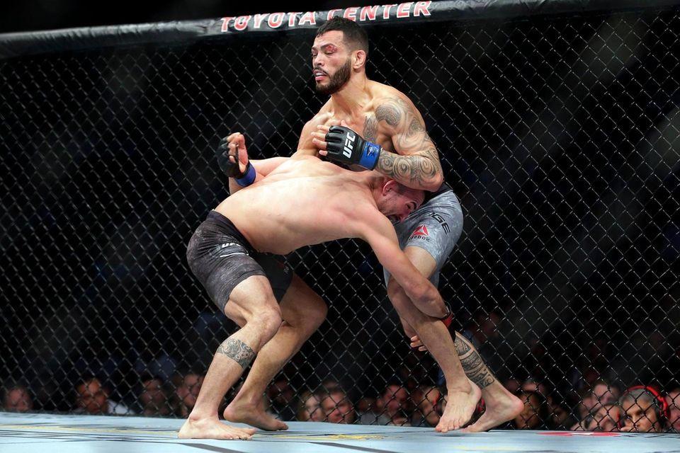Mirsad Bektic, left, grabs the leg of Dan