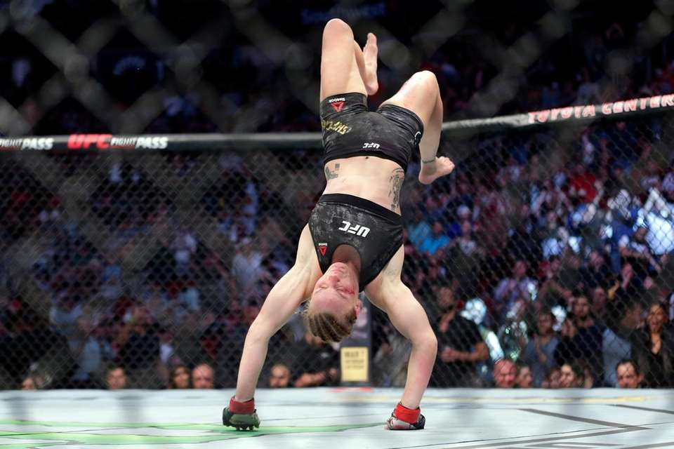 Valentina Shevchecko does a back flip after defeating