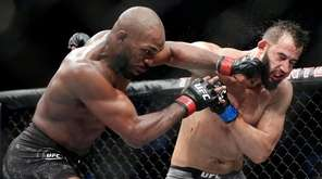 Jon Jones, left, connects with a punch to