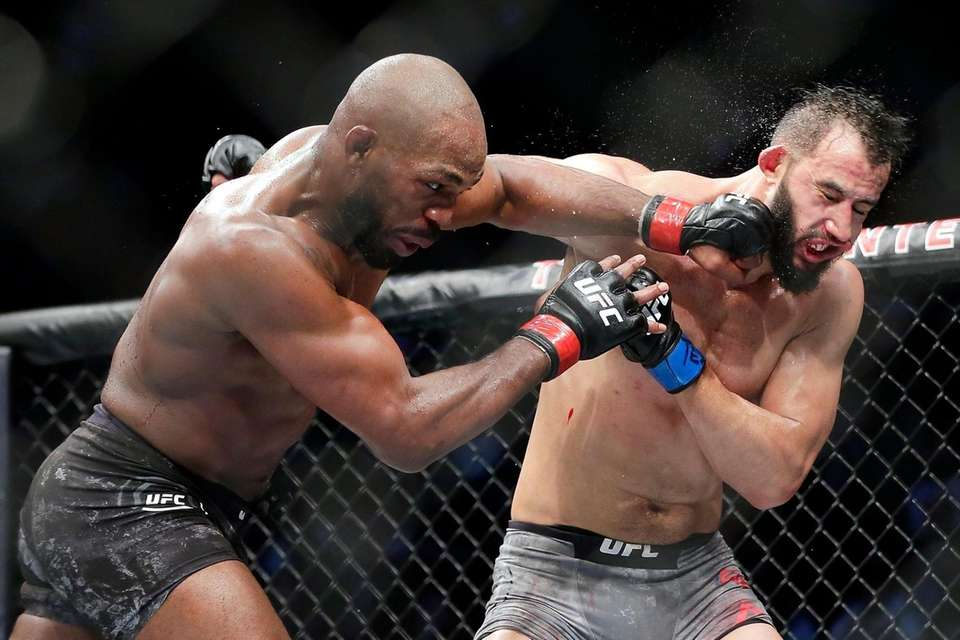 Jon Jones, left, connects a punch on Dominick
