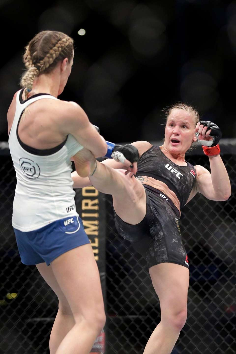 Valentina Shevchecko, right, delivers a kick to Katlyn