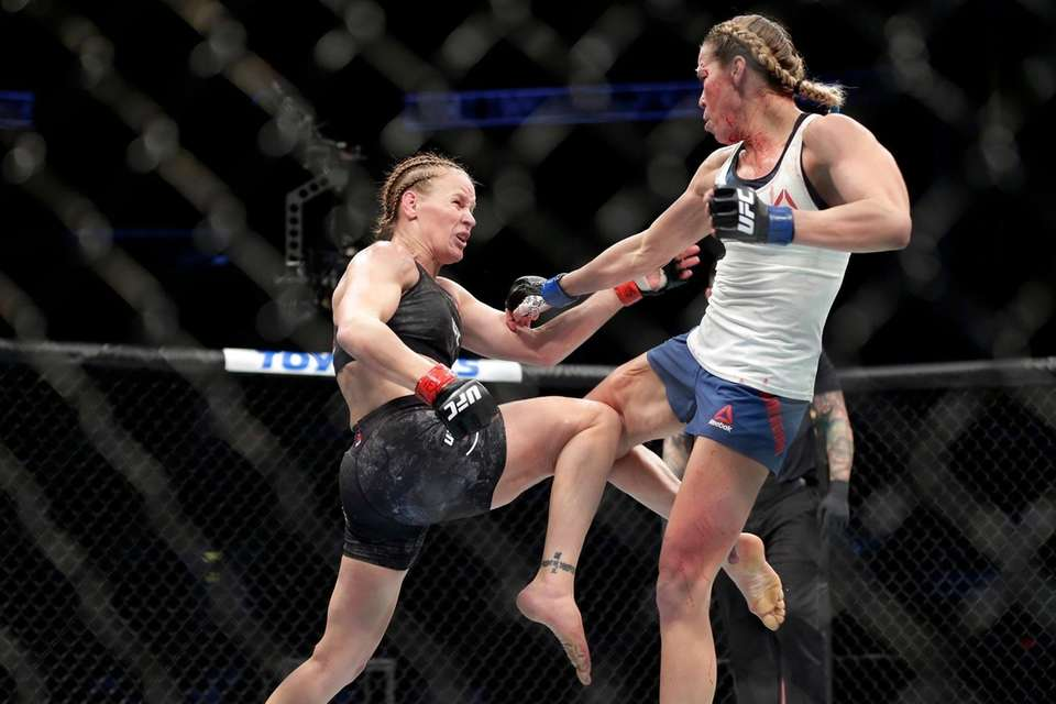Valentina Shevchecko, left, and Katlyn Chookagian battle during