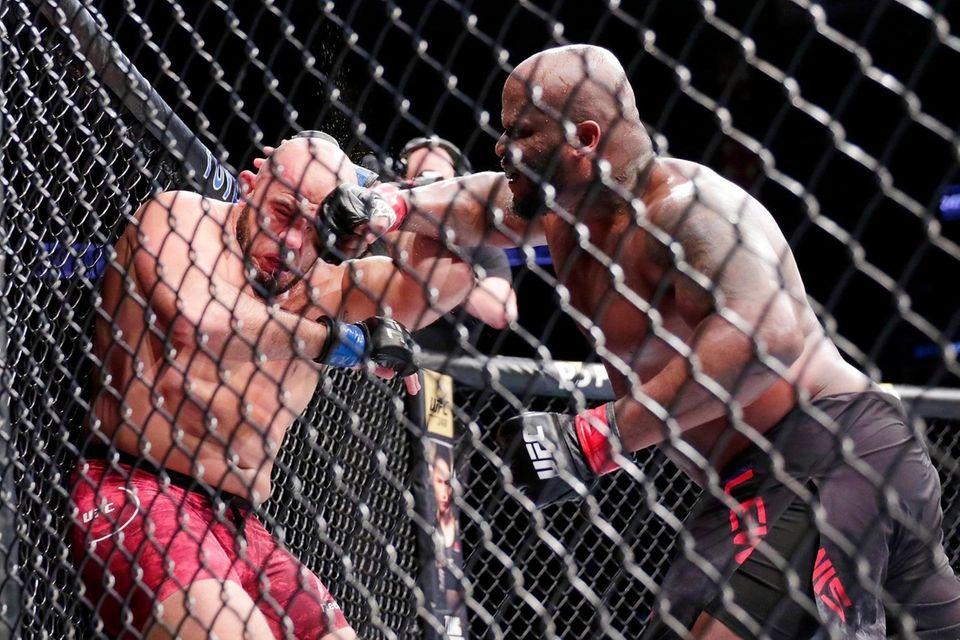Derrick Lewis, right, hits Ilir Latifi during a