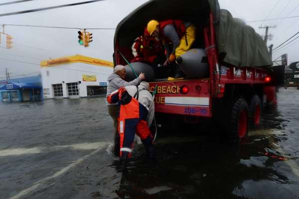 An Island Park resident is rescued by members