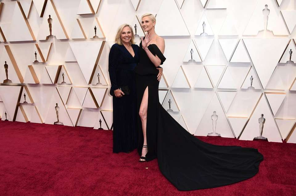 Gerda Maritz, left, and Charlize Theron arrive at