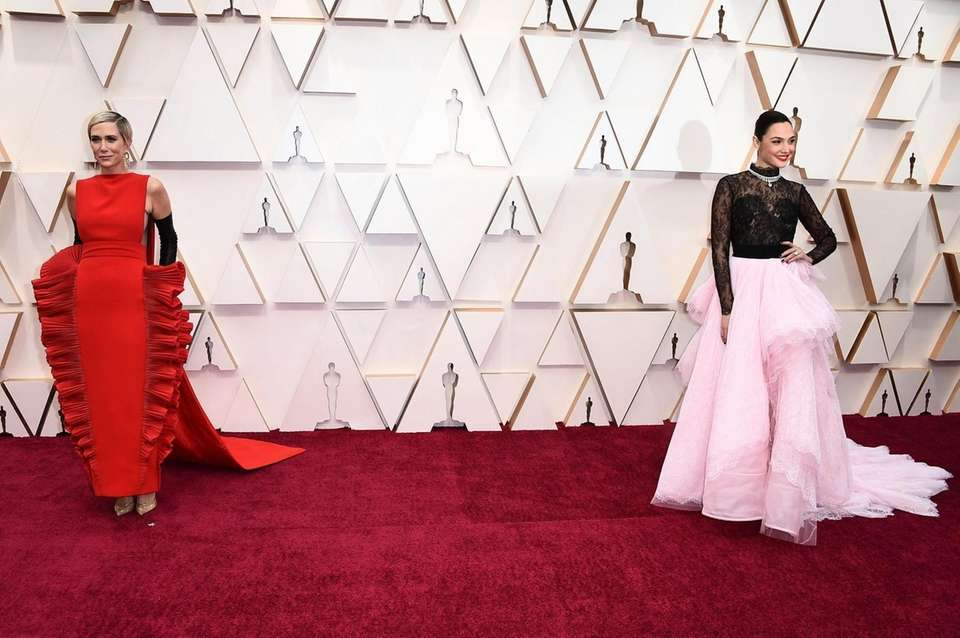 Kristen Wiig, left, and Gal Gadot arrive at