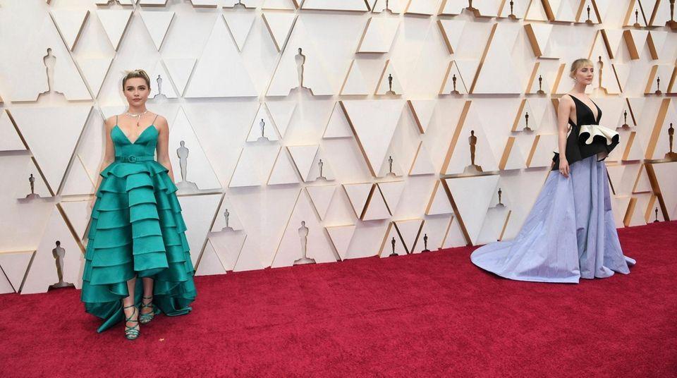 Florence Pugh, left, and Saoirse Ronan arrive at