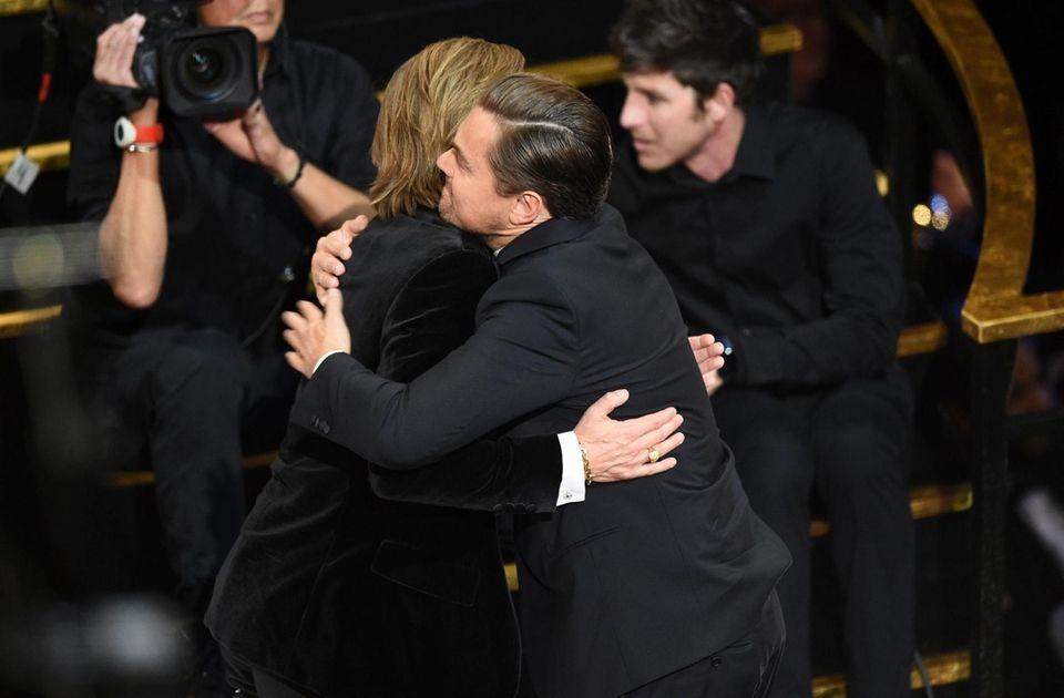 Brad Pitt, left, is congratulated by Leonardo DiCaprio