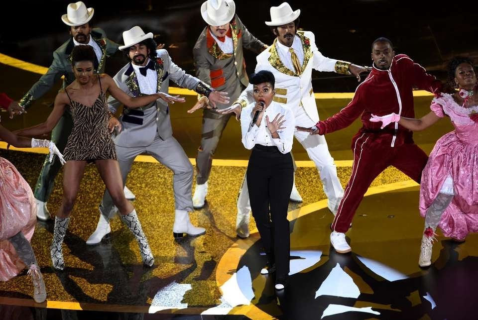 Janelle Monae, center, performs onstage at the Oscars