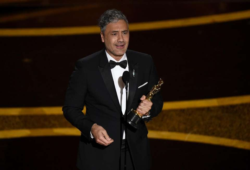 Taika Waititi accepts the award for best adapted