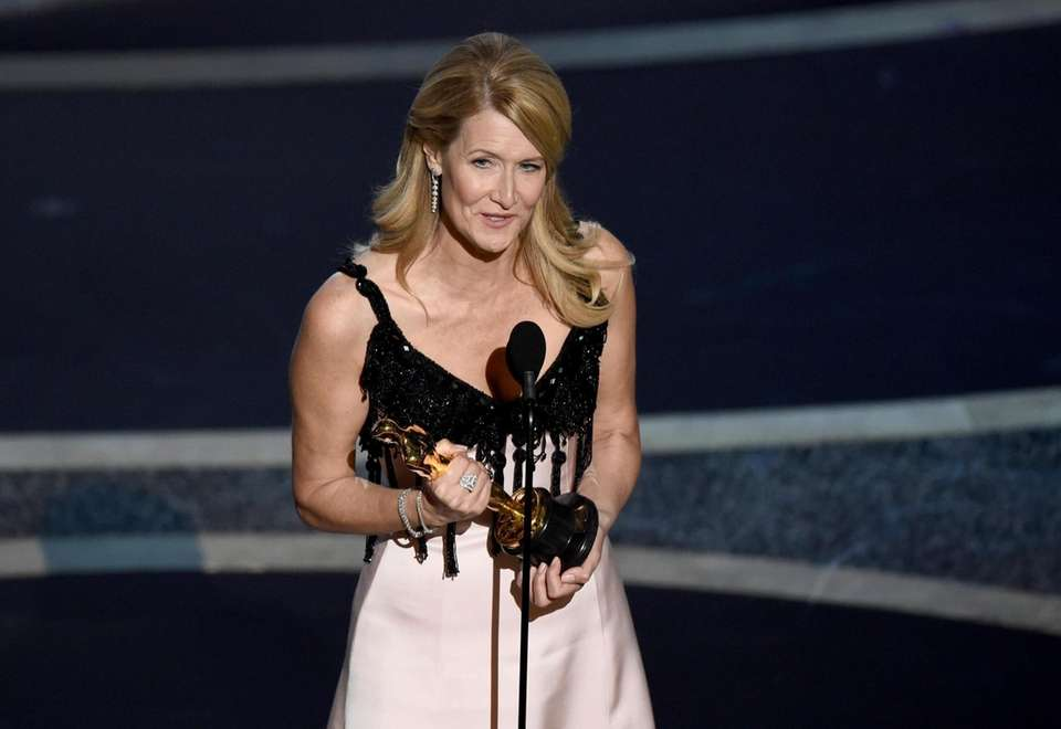 Laura Dern accepts the award for best performance