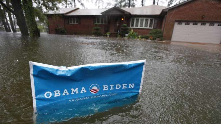 An Obama campaign sign rises above the floodwaters