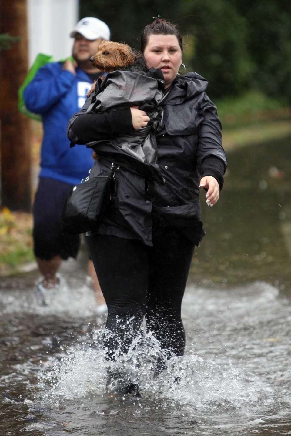 Evonne Bolanos of Bayville carries her dog Roxy