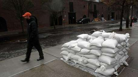Sandbags are viewed on a street in Red