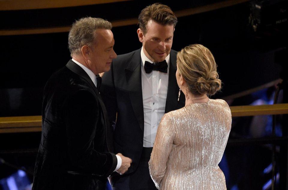 Tom Hanks, from left, Bradley Cooper and Rita