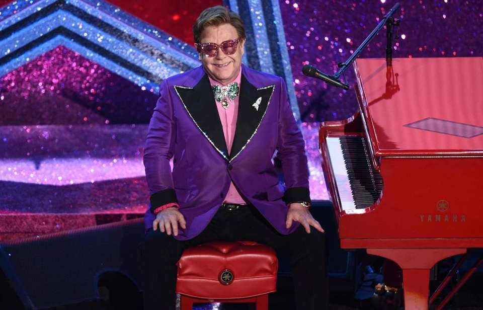 """Elton John is seen after performing """"(I'm Gonna)"""