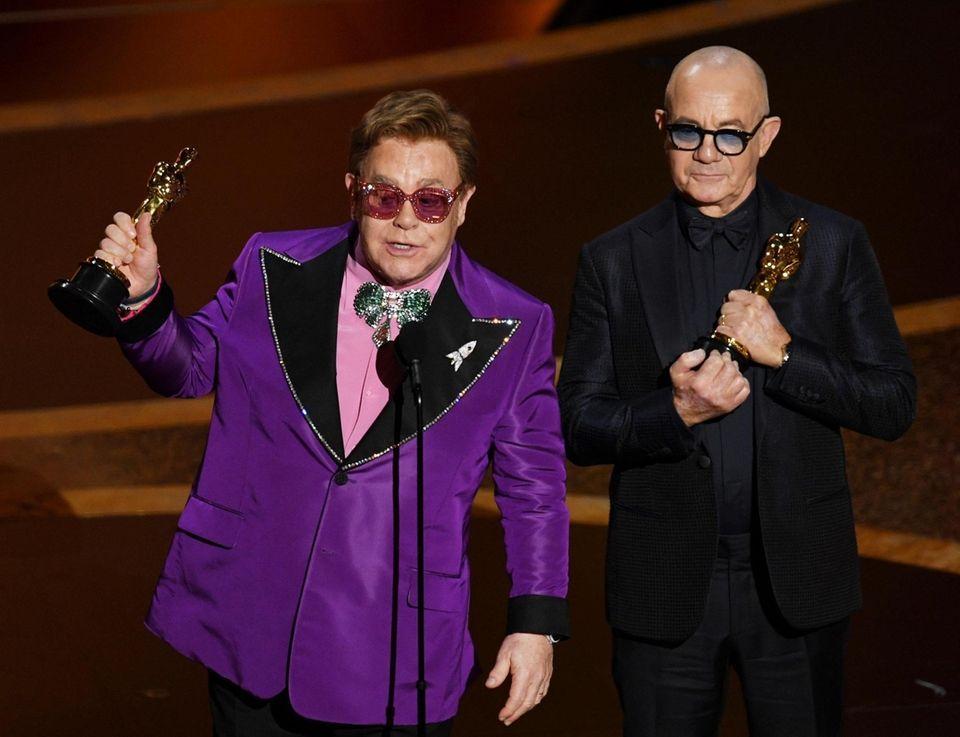 HOLLYWOOD, CALIFORNIA - FEBRUARY 09: (L-R) Elton John