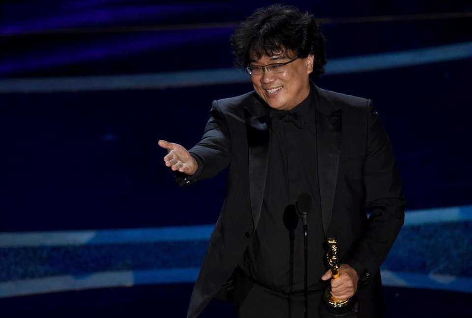 Bong Joon Ho accepts the award for best