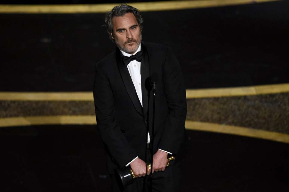 Joaquin Phoenix accepts the award for best performance