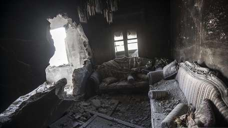 An apartment destroyed by tank shelling is seen