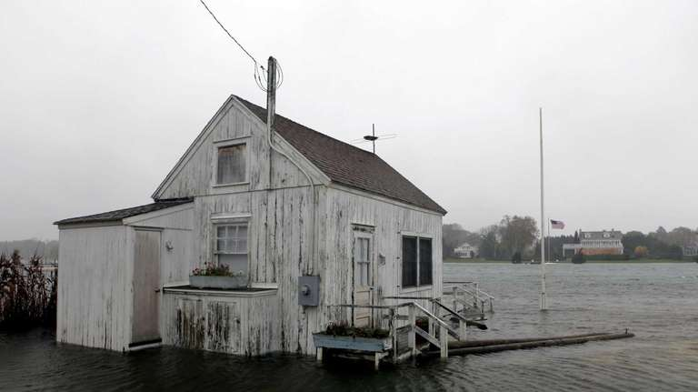 A house is inundated with flood water from